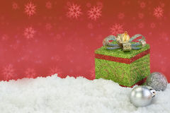 Present box ornament on snow with abstract background Royalty Free Stock Photo