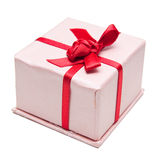 Present box. Pink present box with red ribbon isolated on white Stock Images