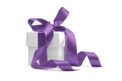 Present box with purple ribbon Stock Photography