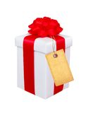Present box with red bow and blank tag isolated on white Royalty Free Stock Photography