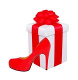Present box with red bow and woman shoe Royalty Free Stock Images
