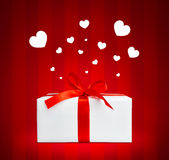 Present box with red ribbon. Stock Image