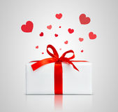 Present box with red ribbon. Royalty Free Stock Photo