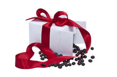 Present box with red ribbon. White present box with sweets and red ribbon royalty free stock photography