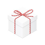 Present box with red twine bow Royalty Free Stock Images