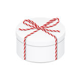 Present box with red twine bow Royalty Free Stock Photo