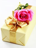 Present box and rose Royalty Free Stock Photo