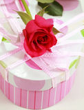 Present box and rose Stock Photography