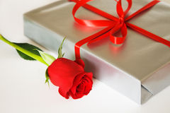 Present box and rose. Present box and red rose Stock Photography