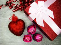 Present box with rose flowers greeting card valentine`s day love. Gift box with roses flowers greeting card love valentine`s day with hearts Royalty Free Stock Photography