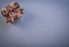 Present box in shop brown paper on grey background celebrations Stock Images