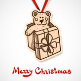 Present box with teddy bear. Paper label on ribbon Stock Images