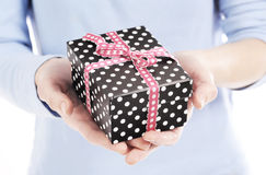 Present box in a woman hand close up Stock Image