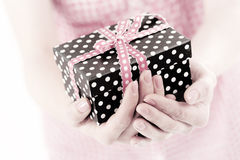Present box in a woman hand close up Royalty Free Stock Photos