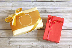 Present box on wooden background Royalty Free Stock Image