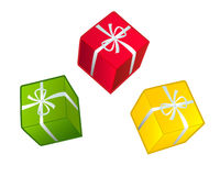 Present boxes. Tree colorful holiday presents with white ribbons Royalty Free Stock Photo