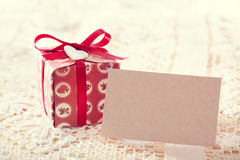 Present boxes and blank message card. Hand made present boxes with red ribbons and heart shaped tags and blank message card stock images