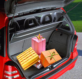 Present boxes in a car. A fancy boxes in the passenger compartment of car Royalty Free Stock Image