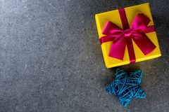 Present boxes on dark background greeting card holidays concept. New year, christmas theme Stock Photo