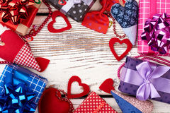 Present boxes and fabric hearts. royalty free stock photography