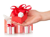 Present boxes and female hand with gift Stock Photos