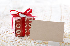 Present boxes and heart shaped tags with blank message card Royalty Free Stock Photos