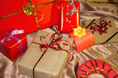 Present boxes photozone. Present boxes on a gold background texture stock image