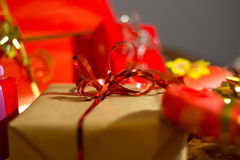 Present boxes photozone. Present boxes on a gold background texture stock photos