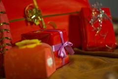Present boxes photozone. Present boxes on a gold background texture royalty free stock photos