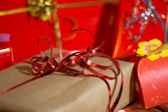 Present boxes photozone. Present boxes on a gold background texture Royalty Free Stock Images