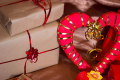 Present boxes photozone. Present boxes on a gold background texture Stock Photo