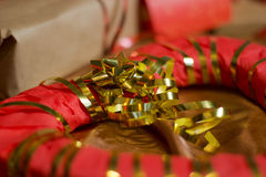 Present boxes photozone. Present boxes on a gold background texture royalty free stock photo
