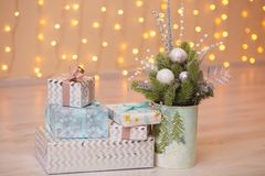Present boxes under fir-tree Stock Photography