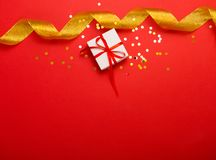 Present on a bright red background Royalty Free Stock Photography