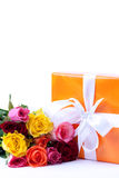 Present and bunch of roses Royalty Free Stock Photography
