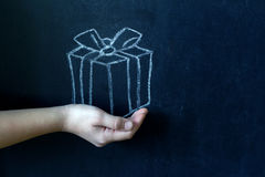 Present and child`s hand abstract background concept Stock Photography