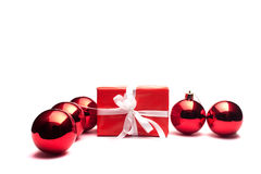 Present and christmas balls. On a white background Stock Image
