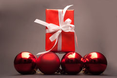 Present and christmas balls. On a black background Royalty Free Stock Image