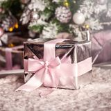 Present christmas box with tender pink ribbon stock images