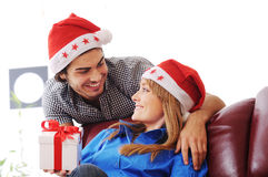 Present christmas and couple. Young couple and present christmas Royalty Free Stock Images