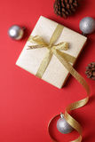 Present with christmas decor on red background - Series 4 Royalty Free Stock Photo
