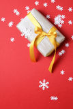 Present with christmas decor on red background - Series 5 Royalty Free Stock Image
