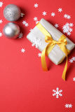 Present with christmas decor on red background - Series 6 Stock Image