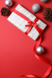 Present with christmas decor on red background Stock Photos