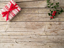 Present and Christmas ornament on wooden background Royalty Free Stock Photography