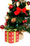 Present and Christmas tree. On white background Stock Photography