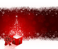 Present with Christmas tree from stars on red back Stock Images