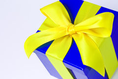 Present - with clipping path. Suprise present in a nice blue package with yellow bow Royalty Free Stock Photos