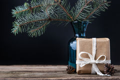 Present with cones and fir tree  brunch in the vase Stock Photos