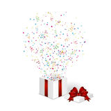 Present with confetti Stock Images